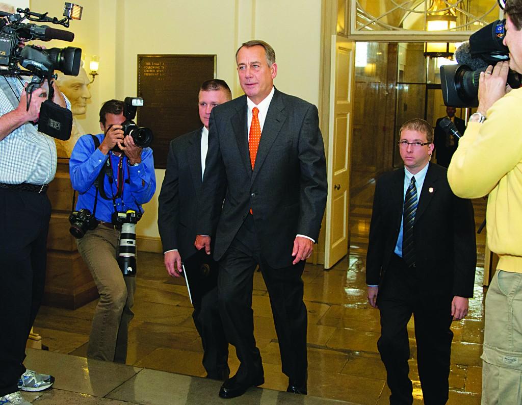 "House Speaker John Boehner of Ohio arrives on Capitol Hill, Wednesday, in Washington. ""We fought the good fight. We just didn't win,"" conceded House Speaker John Boehner. (AP Photo/Carolyn Kaster)"