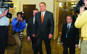 Speaker of the House John Boehner (R-Ohio) walks after the Senate leaders reached last-minute agreement Wednesday to avert a threatened Treasury default and reopen the government. (AP Photo/J. Scott Applewhite)