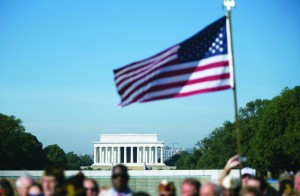 The Lincoln Memorial is seen in the distance during a rally at the National World War II Memorial, Tuesday, in Washington, by the Military Coalition, a coalition of 33 of the leading veterans and uniformed services organizations, to demand an end to the partial government shutdown. (AP Photo/Carolyn Kaster)
