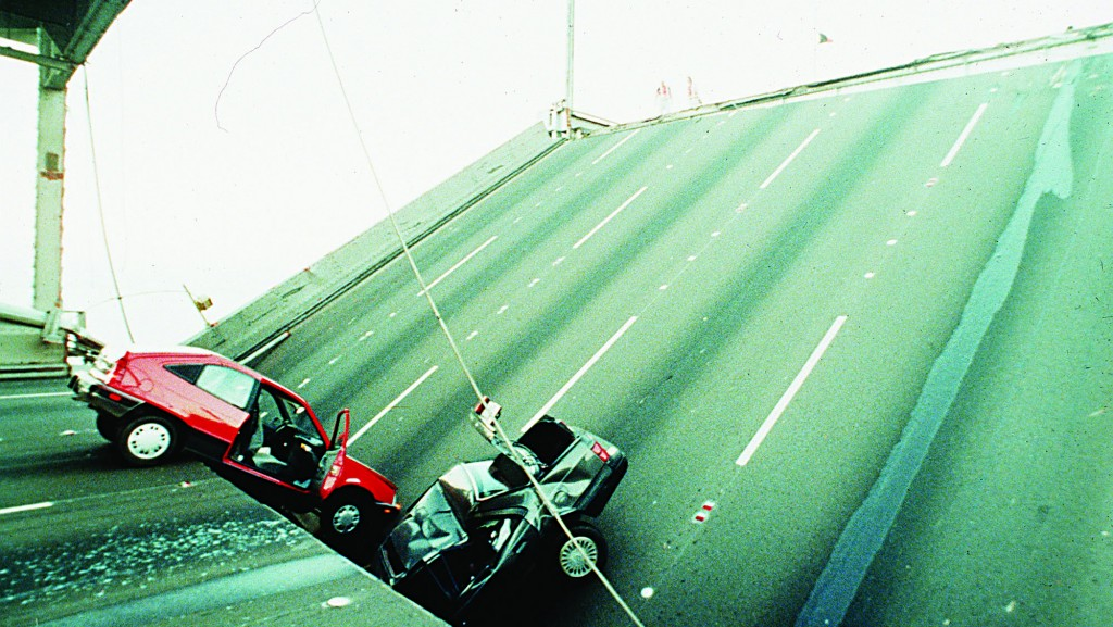 Cars are sandwiched in damaged sections of the Bay Bridge, near Oakland, Tuesday evening, Oct. 17, 1989, after the bridge came apart following a major earthquake that rocked the San Francisco Bay area. (AP Photo)
