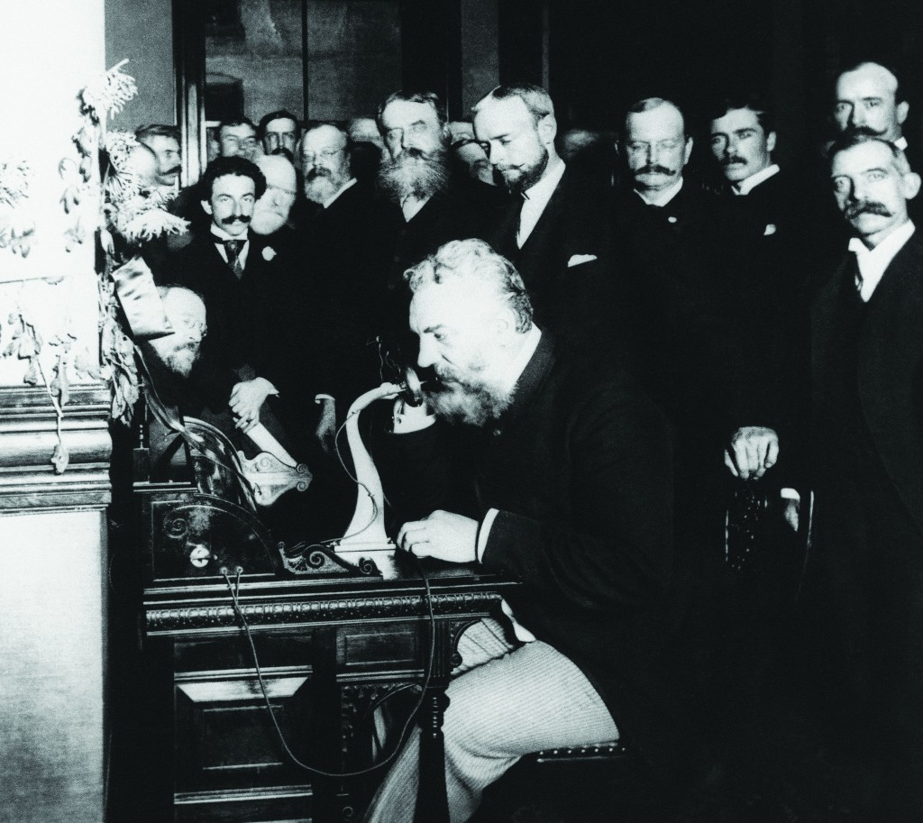 Alexander Graham Bell is shown on the telephone at the opening of the New York-Chicago long distance telephone line, Oct. 18, 1892. It was 1876 when Bell opened the telephone age when he summoned his assistant Thomas A. Watson from the next room by phone. (AP Photo)
