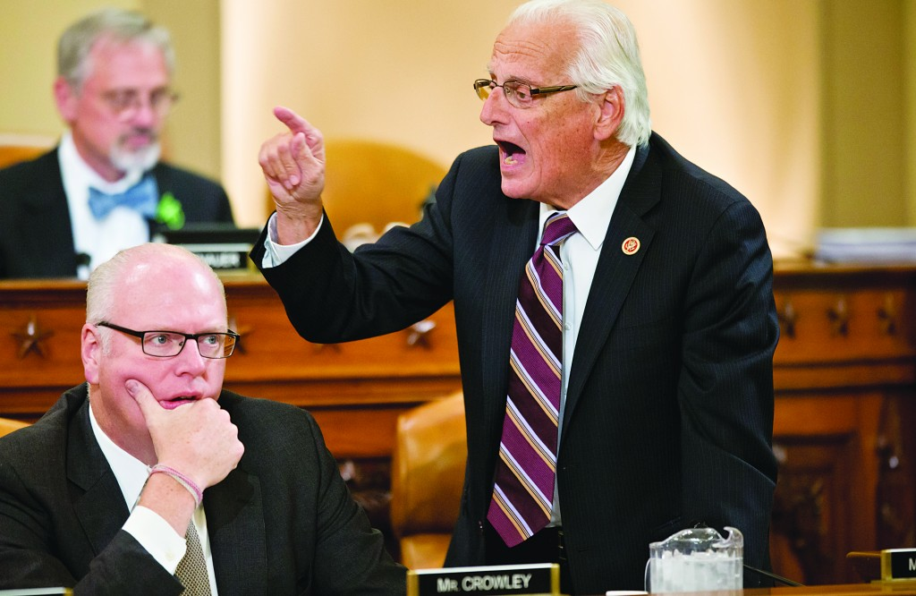 House Ways and Means Committee member Rep. Bill Pascrell, D-N.J., right, stands up and shouts across the room at Republican lawmakers during a heated debate about problems with the implementation of the Affordable Care Act, Tuesday, on Capitol Hill in Washington. (AP Photo/J. Scott Applewhite)