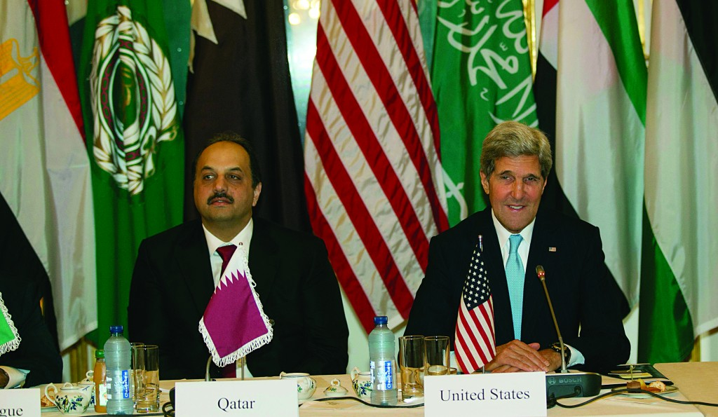 Qatari Foreign Minister Khalid Bin al Attiyah (L) and Secretary of State John Kerry (R) pose prior to meeting with the Arab League in Paris. (REUTERS/Michel Euler/Pool)