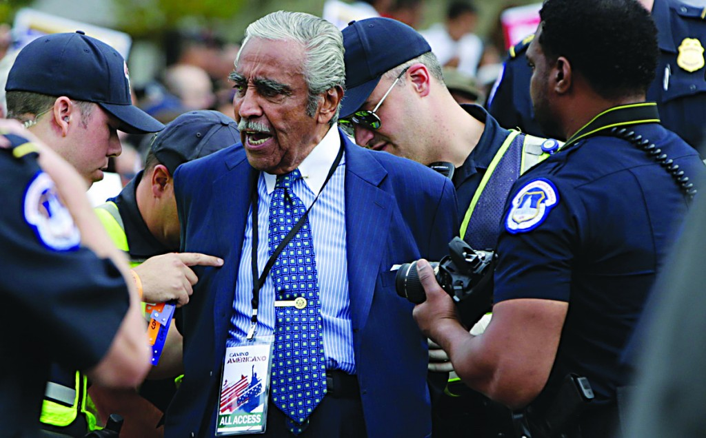 Rep. Charles Rangel is arrested by Capitol Hill police during Tuesday's rally. (Reuters/Gary Cameron)