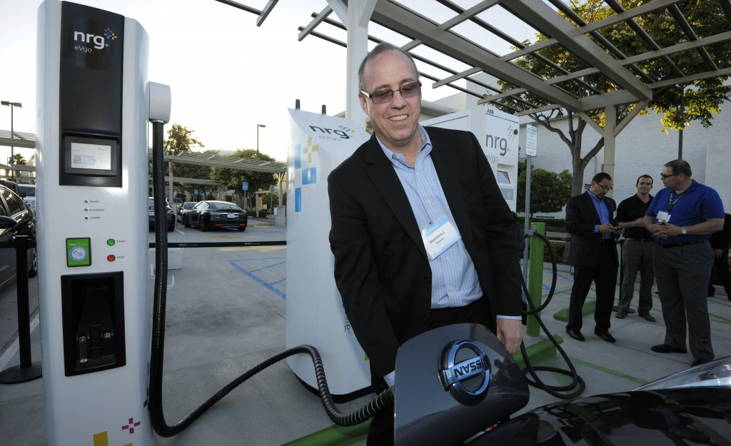 Brendan Jones, Nissan Director of EV Infrastructure Strategy, plugs a 2013 Nissan LEAF into the CHAdeMO fast charger at the unveiling of the first NRG eVgo charging station in the United States able to serve all electric cars at Fashion Valley Mall, in San Diego, Calif. (Denis Poroy/Invision for NRG/AP Images)
