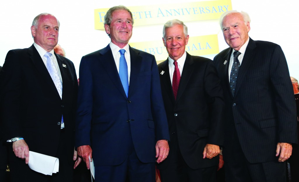 Former President George W. Bush, after his address at the Conference of Presidents dinner at the Waldorf Astoria Hotel, NY. (L-R): Mr. Malcolm Hoenlein, President George Bush, Mr. Robert Sugarman, Mr. Melvin Salberg. (Michael Priest Photography)