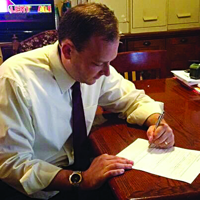 Lee Zeldin on Monday signs papers to run for Congress in Long Island.