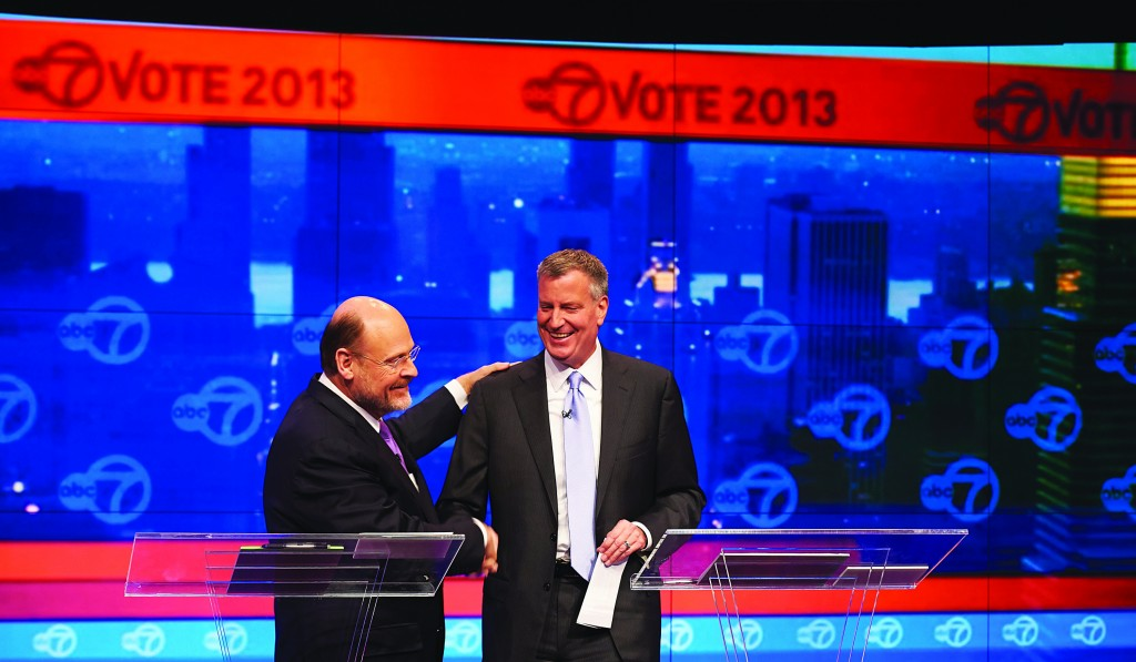 Democrat Bill de Blasio and Republican Joe Lhota on Tuesday night square off in the first of three mayoral debates. (AP Photos)