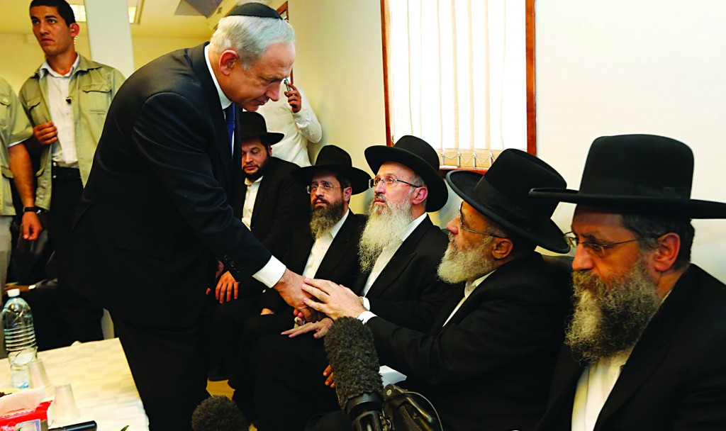 "Israeli Prime Minister Benjamin Netanyahu pays his respects to the family of Harav Ovadiah Yosef, zt""l. (Gil Yohanan/POOL/FLASH90)"