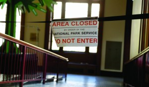 A sign lets visitors know that a portion of the exhibit space at Ellis Island is closed in New York, Monday. (AP Photo/Seth Wenig)