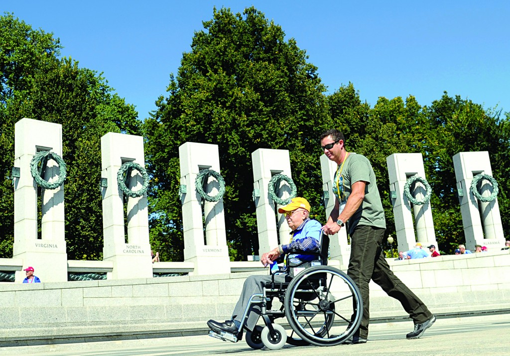 World War II veteran Norman Ring of Greenwood, Mo., is pushed by Tom Loy as they visit the World War II Memorial in Washington, Wednesday.  See story on page 2. (AP Photo/Susan Walsh)