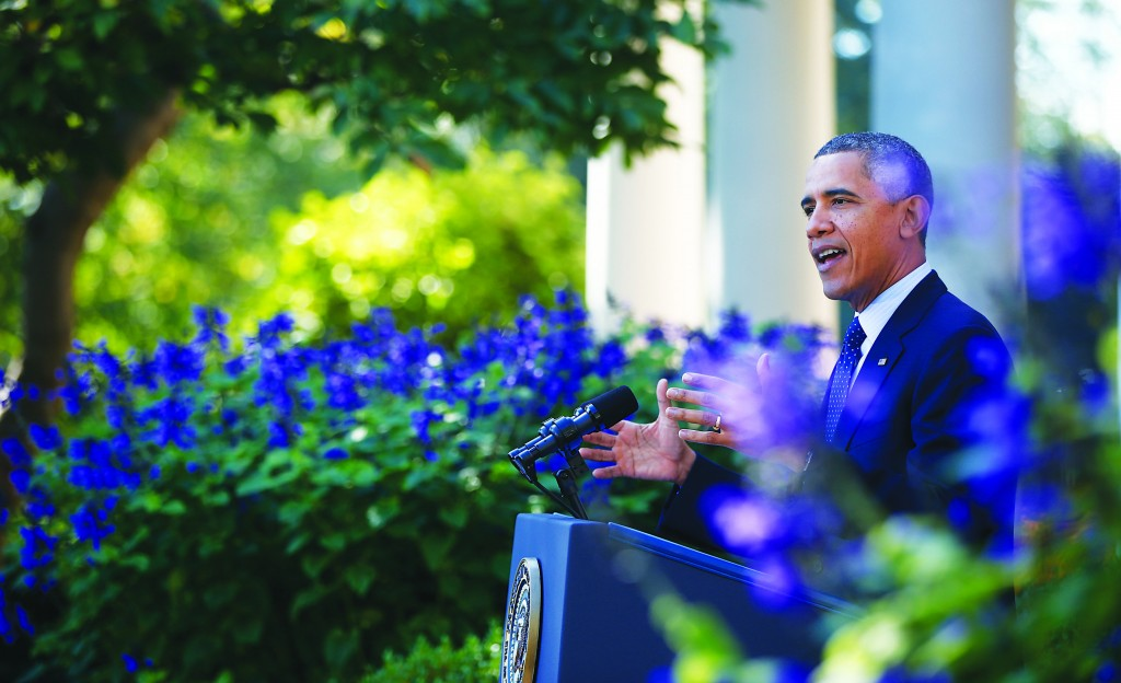 President Barack Obama speaks during an event in the Rose Garden of the White House on the initial rollout of the health care overhaul on Monday. (AP Photo/Charles Dharapak)