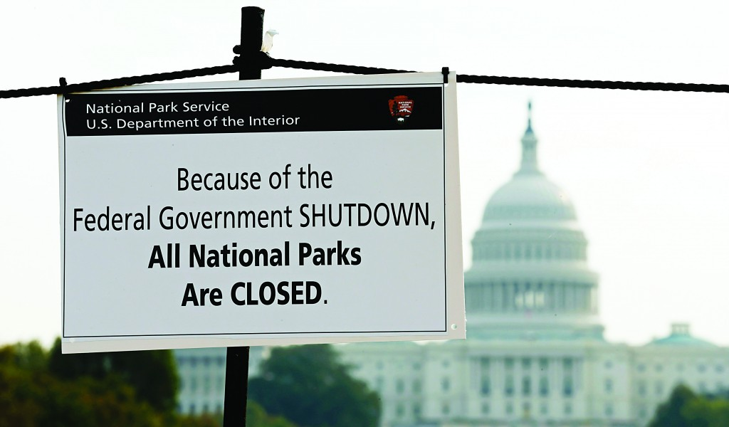 The U.S. Capitol looms in the background as a sign on the National Mall in Washington reminds visitors of the closures to all national parks due to the shutdown. (REUTERS/Kevin Lamarque)