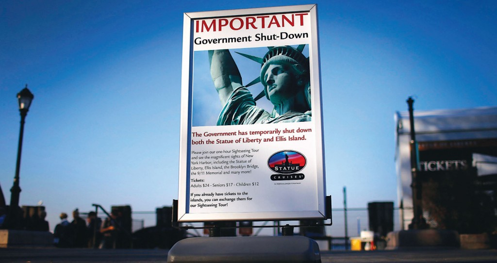 A sign announcing the closure of the Statue of Liberty, a U.S. National Park, due to the U.S. Government shutdown stands near the ferry dock to the Statue of Liberty in Battery Park in New York, October 1, 2013. (REUTERS/Mike Segar)