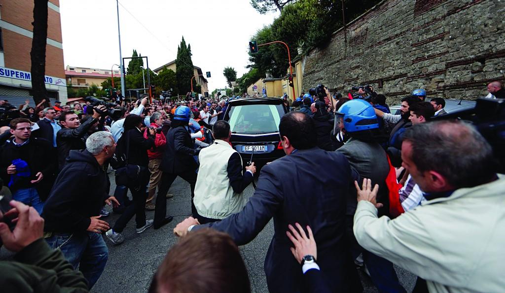 Demonstrators shout as the hearse carrying the coffin of Nazi war criminal Erich Priebke arrives in Albano Laziale near Rome. (REUTERS/Yara Nardi)