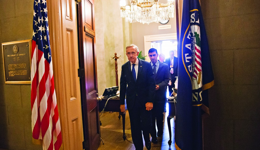 Senate Majority Leader Harry Reid (D-Nev.) leaves the Capitol office of his Republican counterpart, Senate Minority Leader Mitch McConnell (R-Ky.), in Washington, Monday morning. (AP Photo/J. Scott Applewhite)