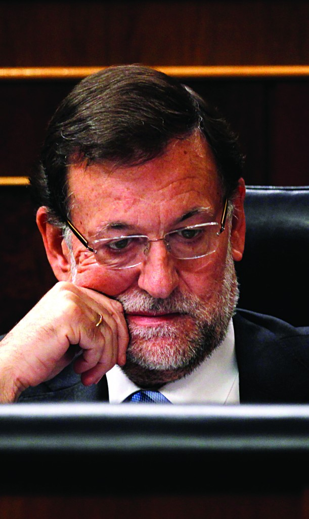 Spain's Prime Minister Mariano Rajoy listens to a lawmaker at the Spanish parliament, in Madrid, Wednesday. (AP Photo/Francisco Seco)