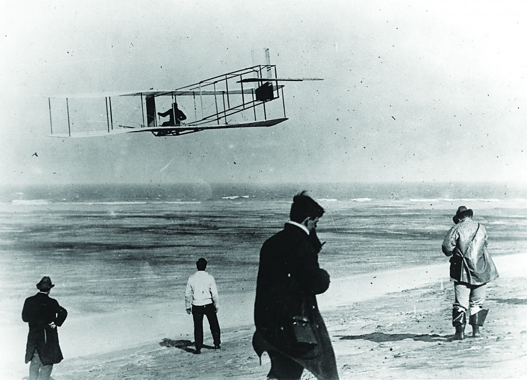 In this undated file photo, Orville and Wilbur Wright test their airplane on a beach. (AP Photo/File)