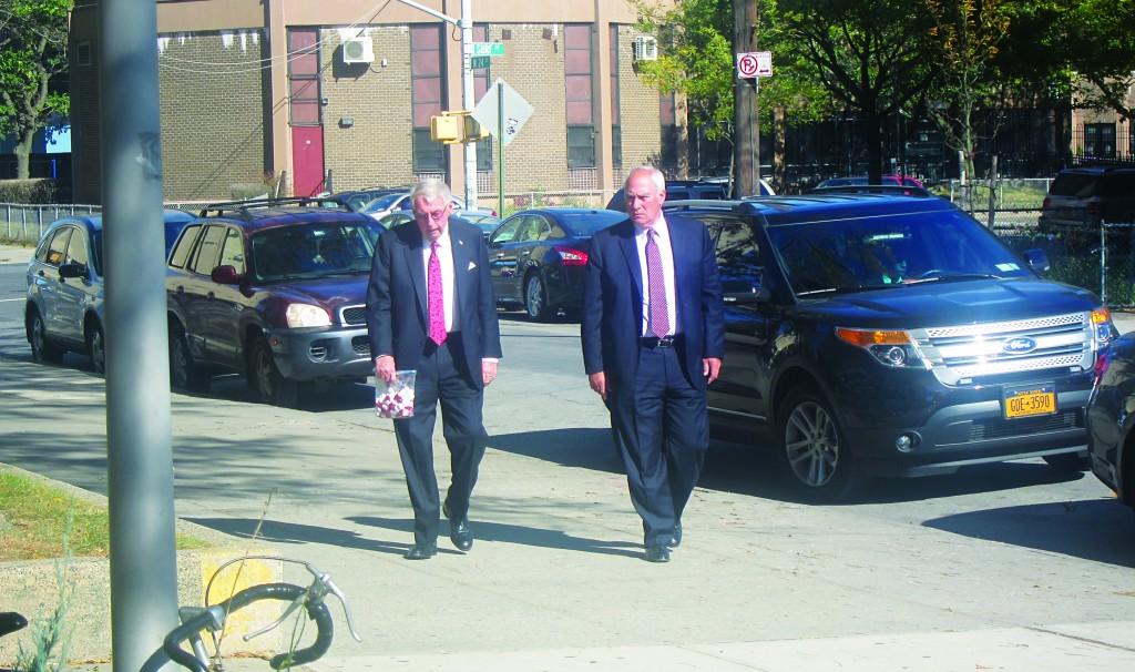 Charles Hynes (L) walking toward a Coney Island senior center last Thursday for a campaign stop. (Yochonon Donn/Hamodia Photo)
