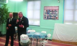 Charles Hynes speaking at a Coney Island senior center last Thursday. Aide Alexander Gurevich is at his left. (Yochonon Donn/Hamodia Photo)