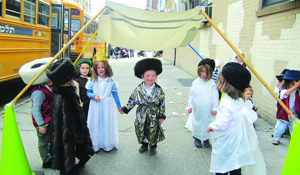 Children of the Munkatcher Cheder act out the historic narrative taking place in this week's parashah. (Asher Frankel)