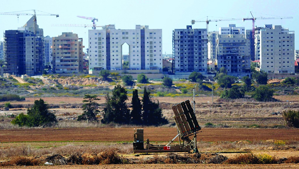 An Iron Dome missile interceptor battery seen deployed in the coastal city of Ashkelon on Monday. (REUTERS/Amir Cohen)