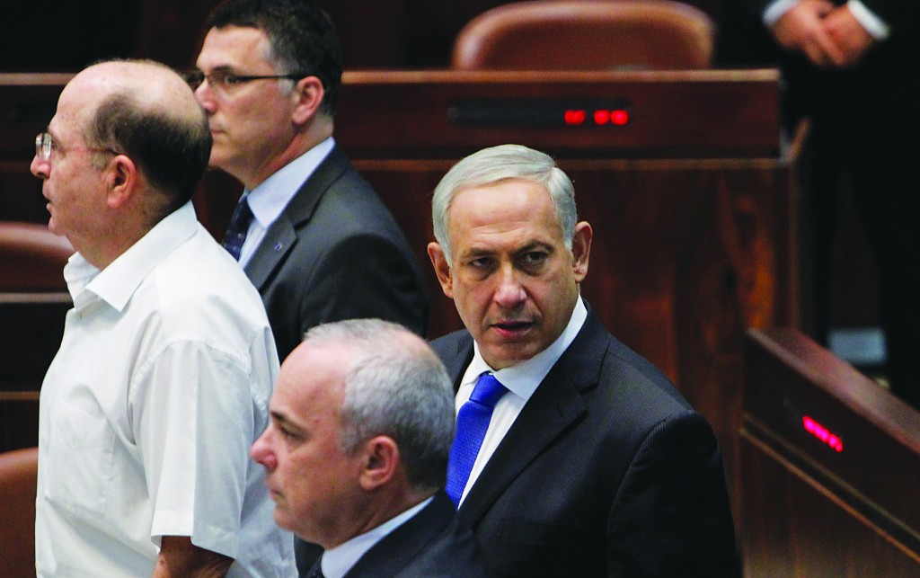 Israeli Prime Minister Binyamin Netanyahu (R) seen in the plenum hall of the Knesset during the opening session on Monday. (Miriam Alster/FLASH90)