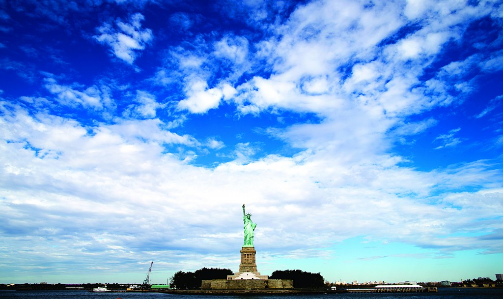 Clouds pass over the Statue of Liberty Saturday, a day before it reopened to the public after the state of New York agreed to shoulder the costs of running the site during the federal government shutdown. (AP Photo/John Minchillo)