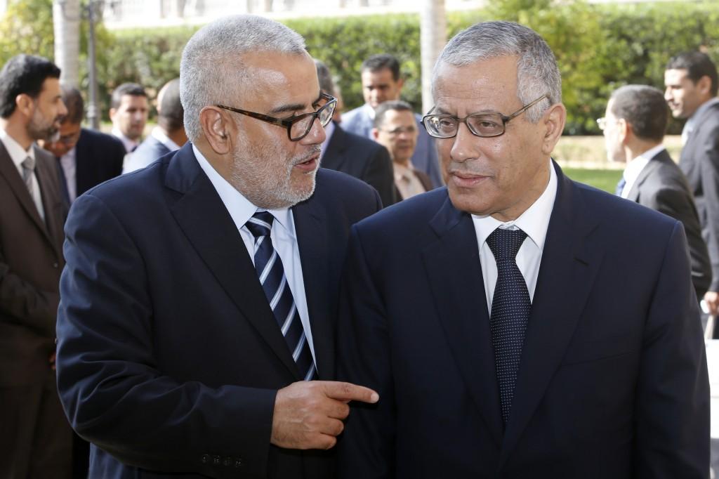 Morocco's Prime Minister Abdelilah Benkirane, left, and his Libyan counterpart Ali Zeidan arrive for a press conference in Rabat, Morocco, Tuesday, Oct. 8. (AP Photo/Abdeljalil Bounhar)