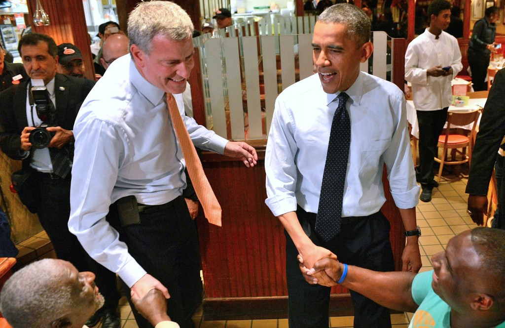 President Barack Obama with Bill de Blasio, left, at a Brooklyn restaurant on Friday. (AP Photo/The Daily News, Aaron Schowalter)