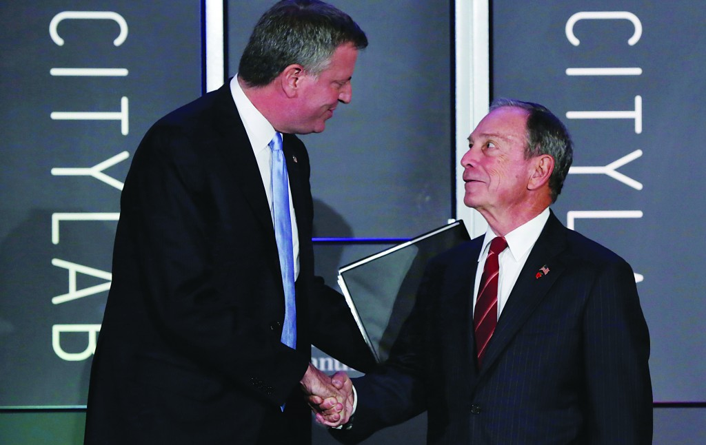 Democrat Bill de Blasio (L) on Tuesday shakes hands with Mayor Michael Bloomberg before he delivers his remarks at the CityLab luncheon in New York. Republican Joe Lhota (R) delivers his remarks at the CityLab luncheon. (AP Photo/Richard Drew)