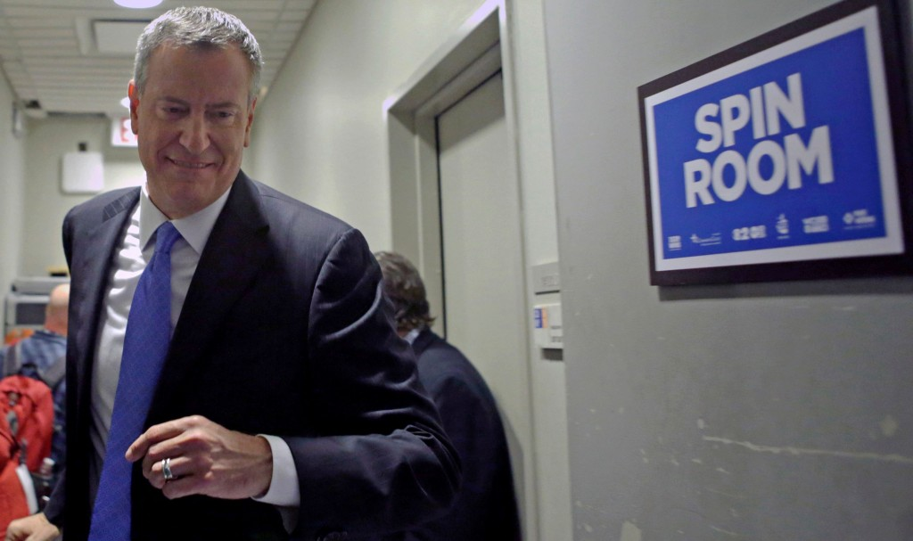 Democrat Bill de Blasio (L) heads to the spin room after participating in the second of three debates Tuesday, and Republican Joe Lhota (R) leaves the spin room. (AP Photo/ Kathy Willens)
