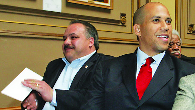 Luis Quintana (left) with Sen.-elect Cory Booker in this file photo.