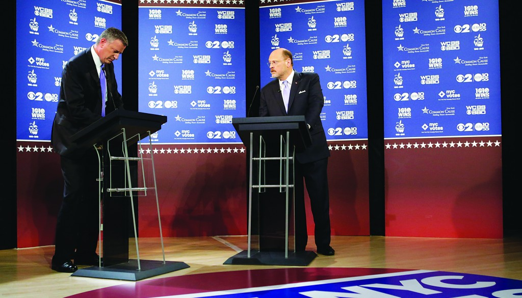 New York City Democratic mayoral candidate Bill de Blasio, left, and Republican candidate Joe Lhota prepare for the second of three debates prior to the Nov. 5 general election, Tuesday, Oct. 22, 2013, in New York. (AP Photo/ Kathy Willens, Pool)