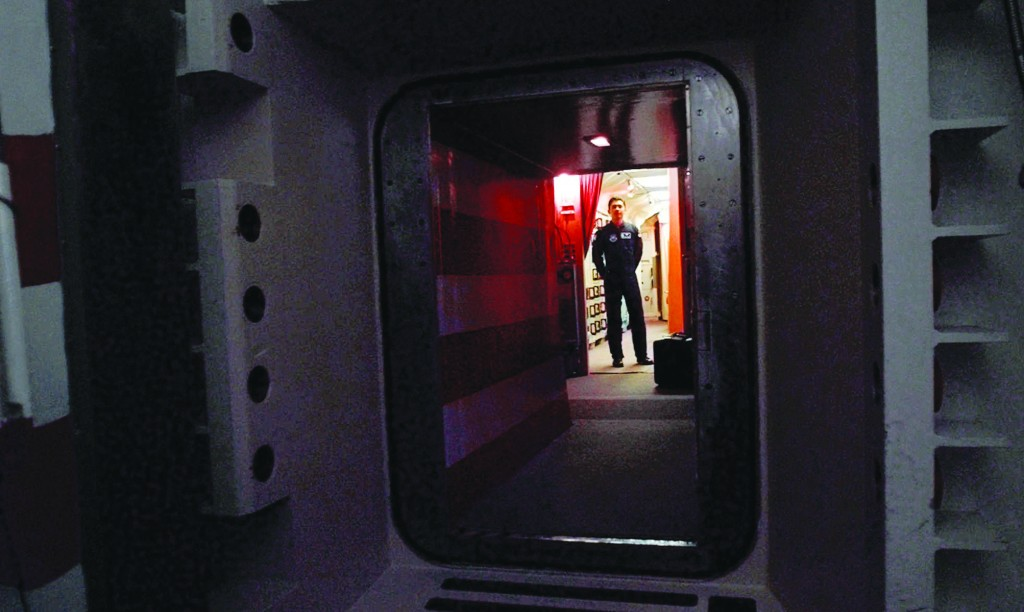 This file photo shows an Air Force missile crew commander standing at the door of his launch capsule 100-feet under ground where he and his partner are responsible for 10 nuclear-armed ICBM's, in north-central Colorado. (AP Photo/Eric Draper, File)
