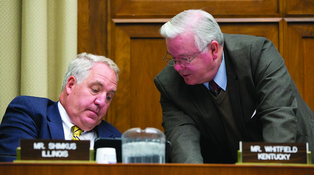 House Energy and Commerce Committee members Rep. Joe Barton (R-Texas) (R) and Rep. John Shimkus (R-Ill.) talk on Capitol Hill in Washington during the committee's hearing with contractors who built the federal government's health-care websites, Thursday. (AP Photo/ Evan Vucci)