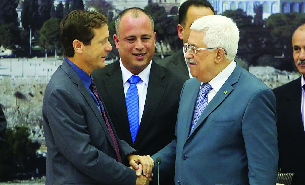 Israeli Labor MK's Isaac Herzog (L) and Hilik Bar (C) seen with Palestinian Authority President Mahmoud Abbas during a meeting in Ramallah. (FLASH90)