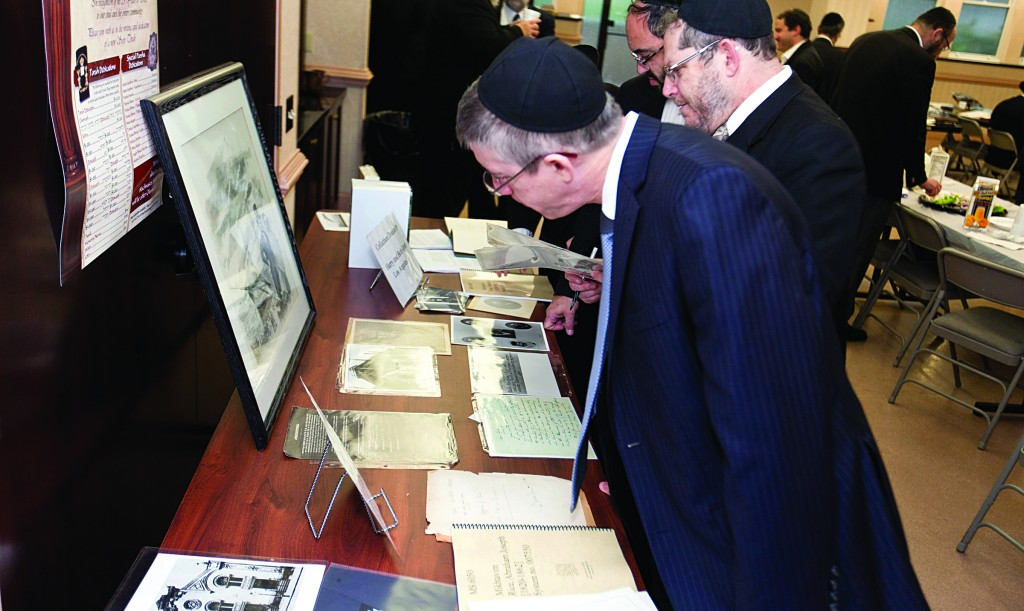 "Visitors at an exhibit about Harav Abraham Yosef Rice, zt""l."