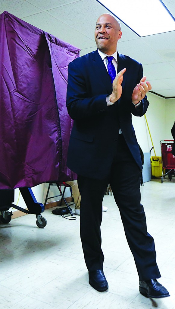 Newark Mayor Cory Booker walks out of a polling booth Wednesday. (AP Photo/Julio Cortez)