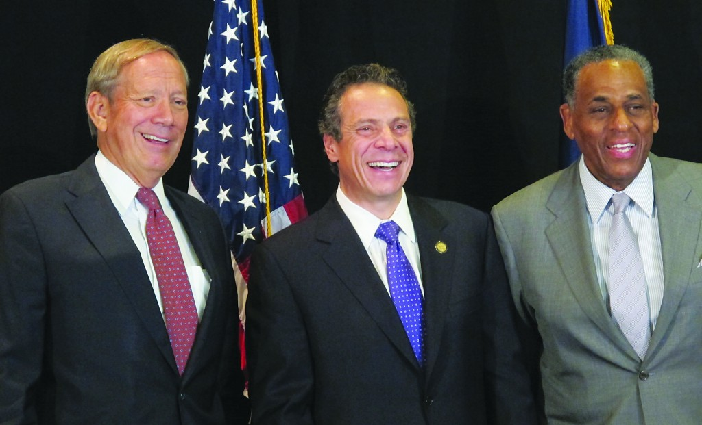 Former New York Gov. George Pataki, Gov. Andrew Cuomo and former state Comptroller Carl McCall pose at Manhattanville College in Purchase, N.Y., on Wednesday upon the establishment of the new Tax Relief Commission. (AP Photo/Jim Fitzgerald)