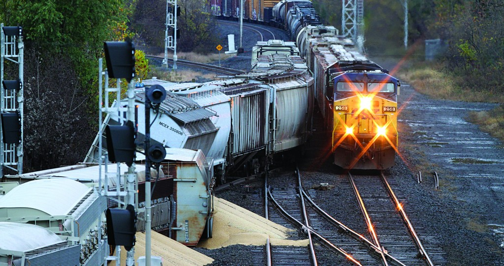 Four train cars were completely derailed early Friday, spilling soy in Perinton, N.Y. No one was injured. (AP Photo/Democrat & Chronicle, Tina Macintyre-Yee)