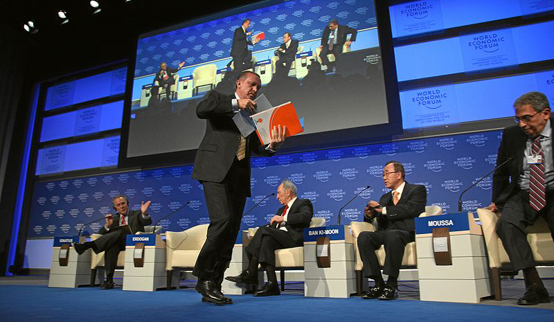 Prime Minister Recep Tayyip Erdogan of Turkey storms out of a session of the 2009 World Economic Forum in Davos, Switzerland, after a heated exchange with Israeli President Shimon Peres over the IDF incursion into Gaza. Looking on are David Ignatius (FLTR), associate editor and columnist for The Washington Post, Peres, Secretary-General of United Nations Ban Ki-moon, and Secretary-General of the League of Arab States Amre Moussa.