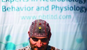 A man demonstrates how he uses a keyboard without typing by wearing a skull-cap with sensors, at a conference on brain technology in Tel Aviv on Tuesday. (REUTERS/Nir Elias)