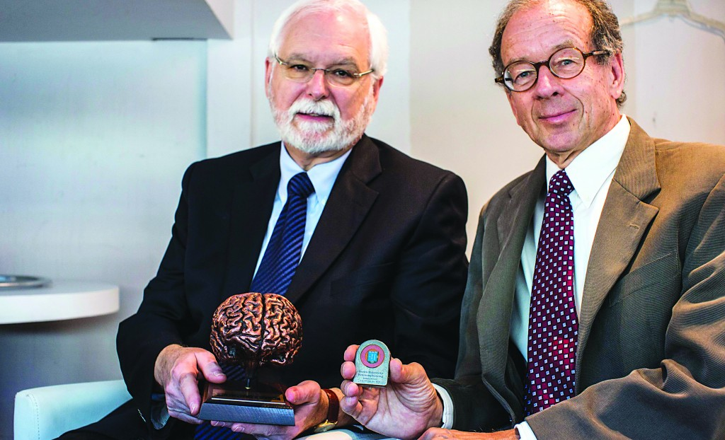 Professors John Donoghue (L) and Arto Nurmikko, of Brown University, pose for a picture after receiving an award for their work in the field of brain technology at a conference in Tel Aviv on Tuesday. (REUTERS/Nir Elias)