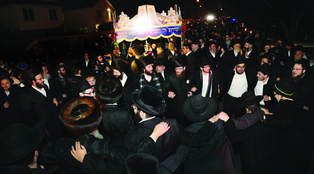 Celebrants dancing at the hachnasas sefer Torah in Sea Gate. (Heshy Rubinstein/Dee Voch)