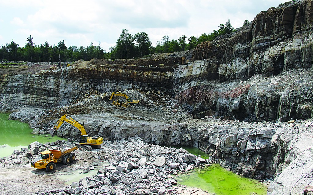 Miners use heavy equipment to dig wollastonite ore from a pit mine in the Adirondacks, the subject of a statewide referendum in three weeks. (AP Photo/Mary Esch)