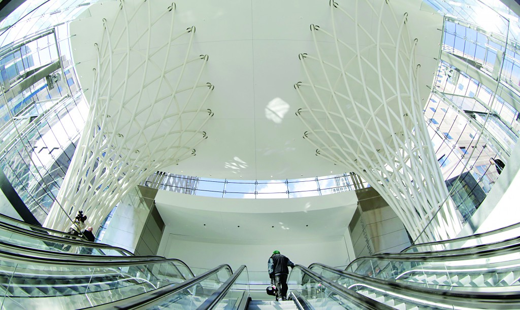 Visitors ride escalators up to the pavilion that takes pedestrians to a newly opened underground WTC concourse, Thursday. (AP Photo/Mark Lennihan)