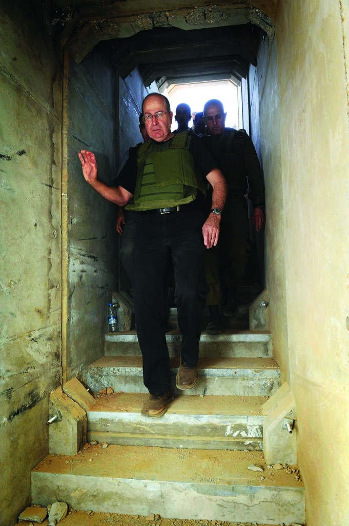 Israeli Defense Minister Moshe Yaalon steps inside the Hamas-built tunnel on Tuesday. (Alon Basson/Ministry of Defense/FLASH90)