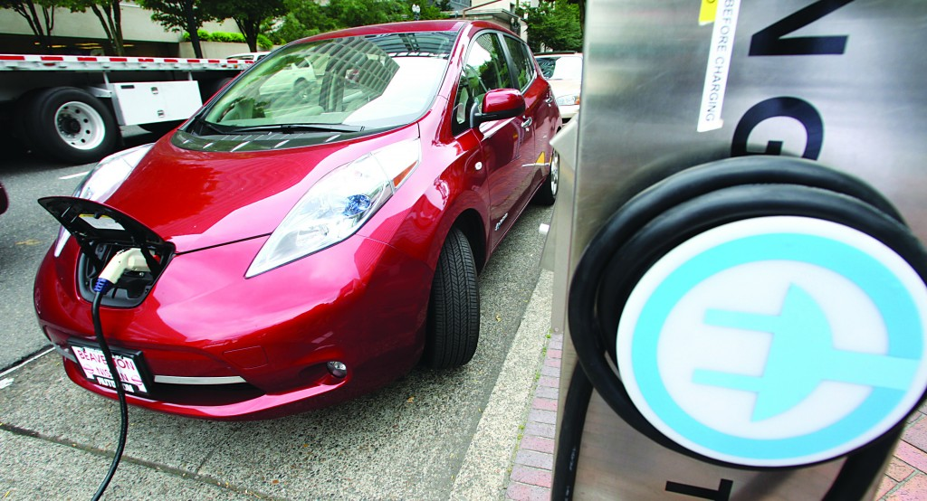 A Nissan Leaf charges at an electric vehicle charging station in Portland, Ore. (AP Photo/Rick Bowmer,File)