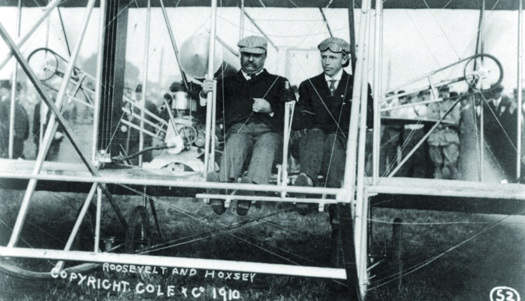 President Theodore Roosevelt and Arch Hoxsey at the St. Louis aerial meet, Oct. 11, 1910. Both seated in Wright airplane prior to flight.